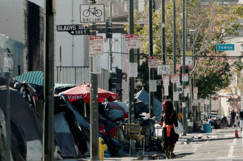 Homeless encampments line the sidewalk along 5th Street in downtown Los Angeles