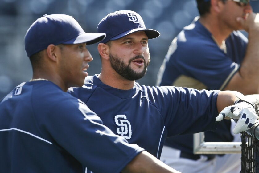 Padres first baseman Yonder Alonso, right, discusses hitting in Petco park with newly acquired third baseman Yangervis Solarte during activities prior a baseball game against the St. Louis Cardinals Wednesday, July 30, 2014, in San Diego.