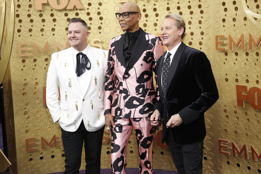 RuPaul, flanked by Ross Mathews, left, and Carson Kressley arriving Sunday at the Emmy Awards at the Microsoft Theater in Los Angeles.