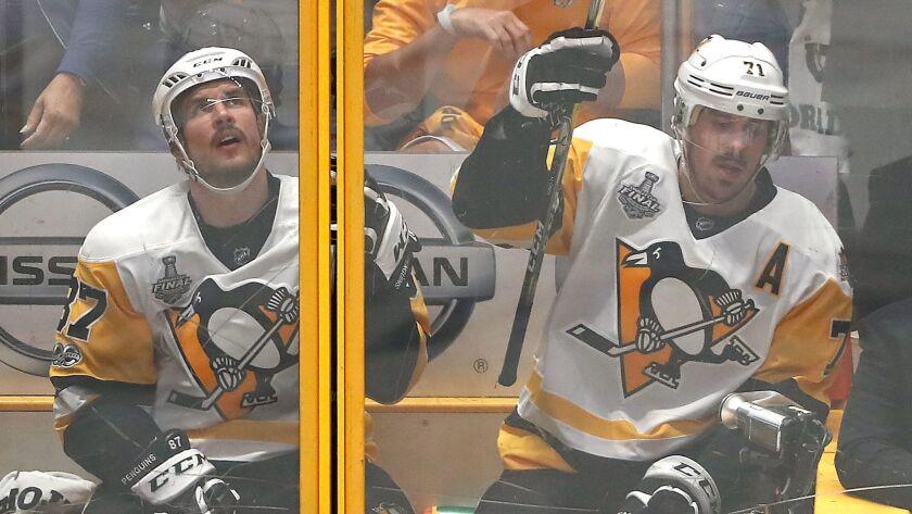 NASHVILLE, TN - JUNE 03: Sidney Crosby #87 and Evgeni Malkin #71 of the Pittsburgh Penguins both sit
