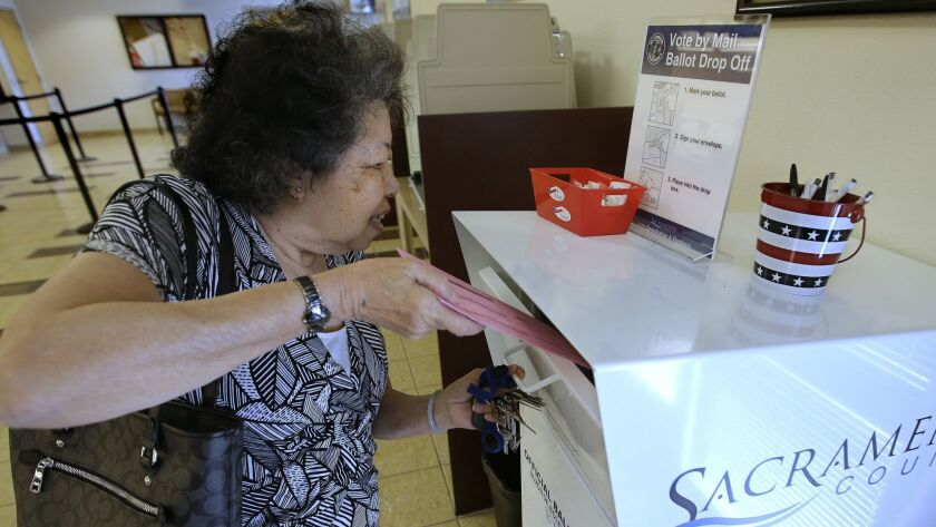 Lei Linh-Pham drops off her mail-in ballot at the Sacramento County Registrar of Voters office, Wedn