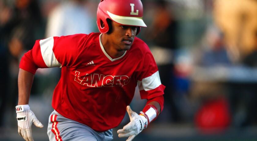 SAN JUAN CAPISTRANO, CALIF. - APRIL 09: Orange Lutheran Lancers Jasiah Dixon (6) runs after hitting