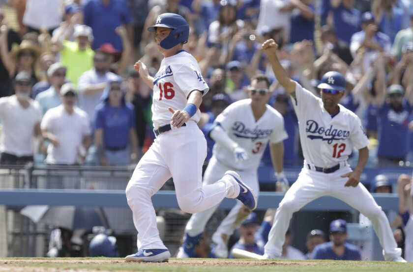 Dodgers catcher Will Smith scores on Russell Martin's walkoff single in the ninth inning to beat the Cardinals 2-1 on Wednesday at Dodger Stadium.