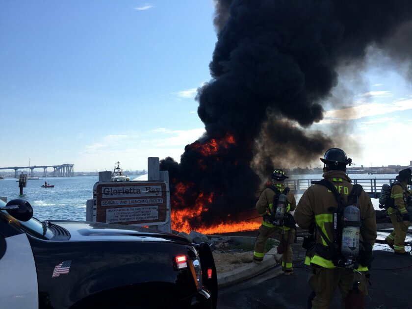 The flaming boat sent up a huge tower of black smoke about 9 a.m. at Glorietta Bay.