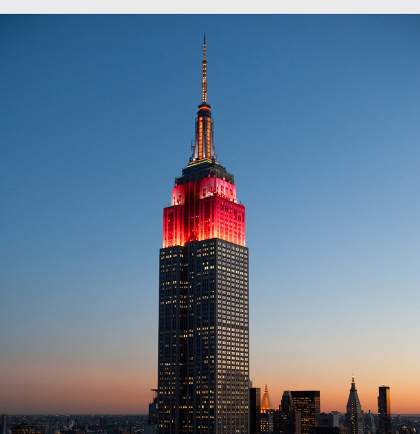 Gold and red lights on the Empire State Building will flash Friday in honor of Chinese New Year.