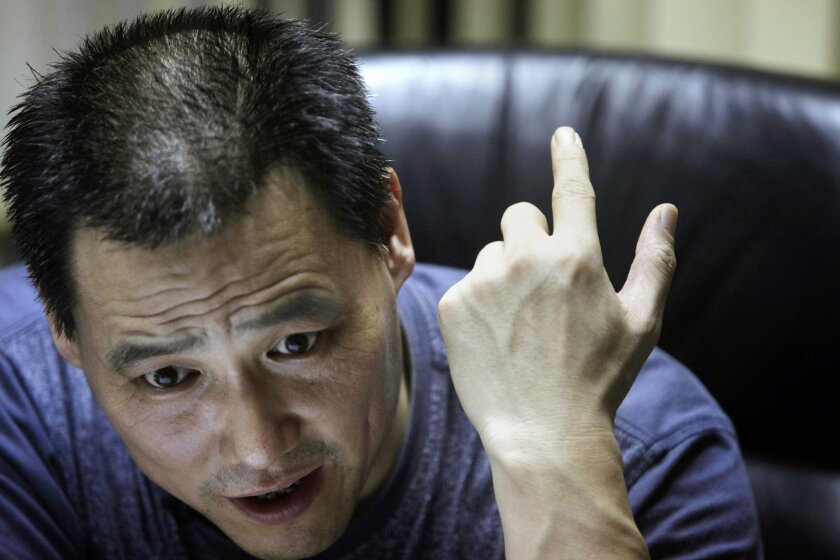 In this photo taken Wednesday, June 30, 2010, Chinese attorney Pu Zhiqiang speaks during an interview at his office in Beijing, China. Police on Friday, June 13, 2014 formally arrested the rights lawyer who is well known in China for his efforts to defend free speech, abolish labor camps and publicize abuses by police and Communist Party officials. (AP Photo/Ng Han Guan)