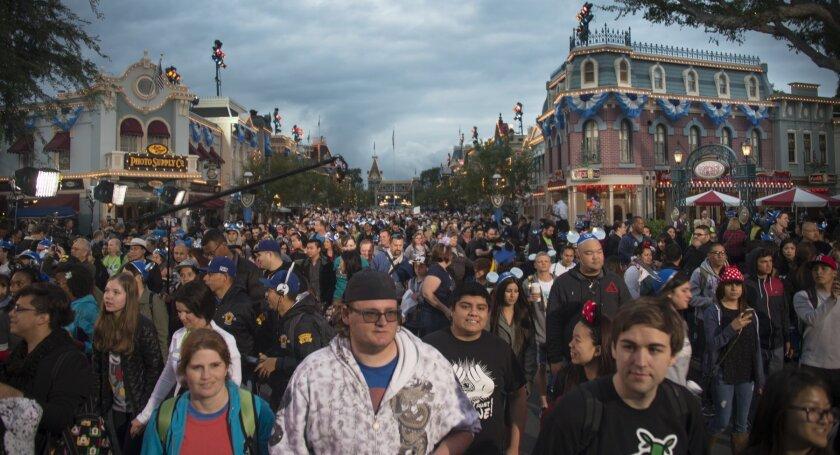 Guests entering Disneyland on Main Street USA