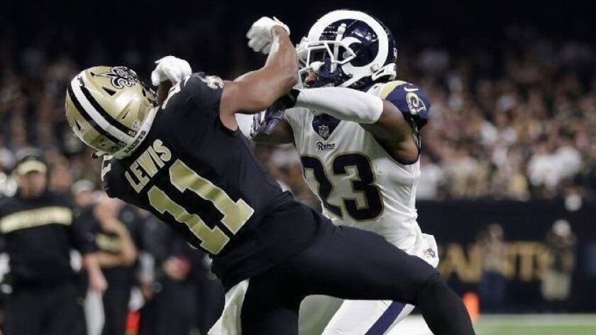 Rams cornerback Nickell Robey-Coleman pushes New Orleans Saints receiver Michael Thomas during second half of the NFC title game.