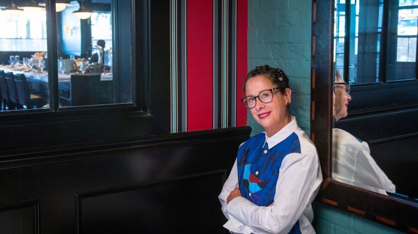 Chef Nancy Silverton, shown at Osteria Mozza in Los Angeles, has tested positive for the novel coronavirus.