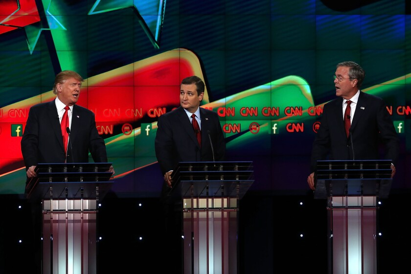 Republican presidential candidates Donald Trump, left, and Jeb Bush get personal during the CNN Republican presidential debate on Tuesday in Las Vegas.