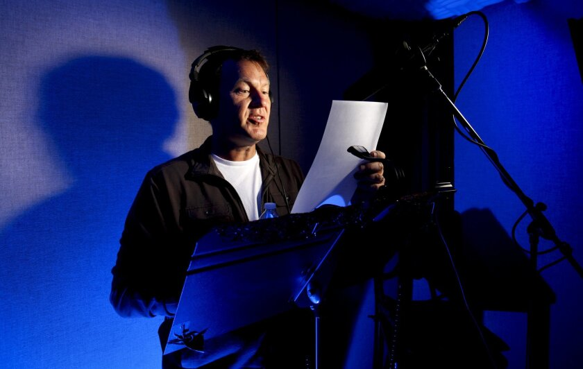 Mike Nelson, founder of RiffTrax, adds his voice to a film during a recording session at the Lethal Sounds studio. HOWARD LIPIN • U-T