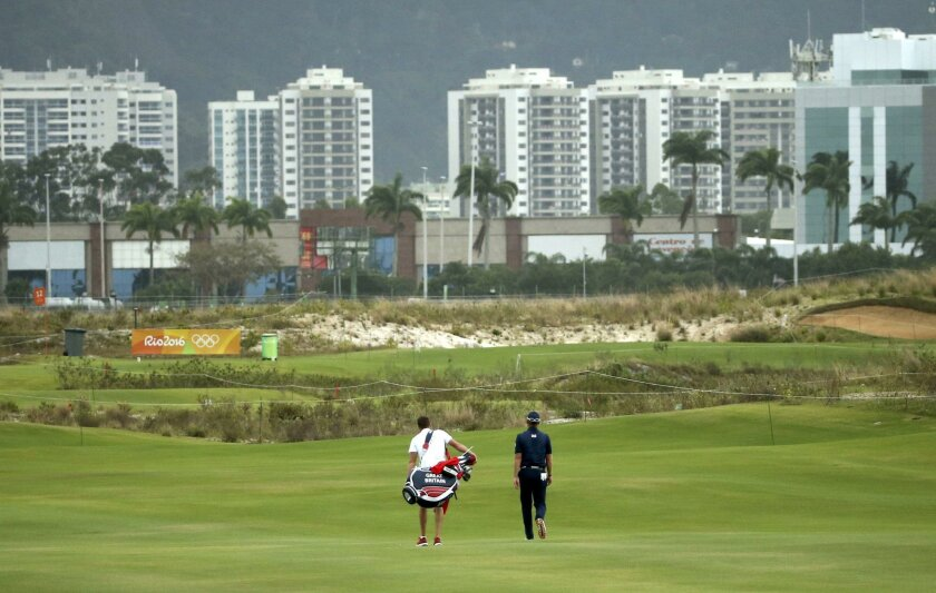 British golfer Danny Willett (right) and his caddie stroll down the fairway of the new Olympic Golf Course.