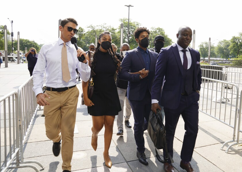 """Former """"Empire"""" actor Jussie Smollett, second from right, arrives the George N. Leighton Criminal Court Building for a hearing on, Wednesday, July 14, 2021 in Chicago (Stacey Wescott/Chicago Tribune via AP)"""