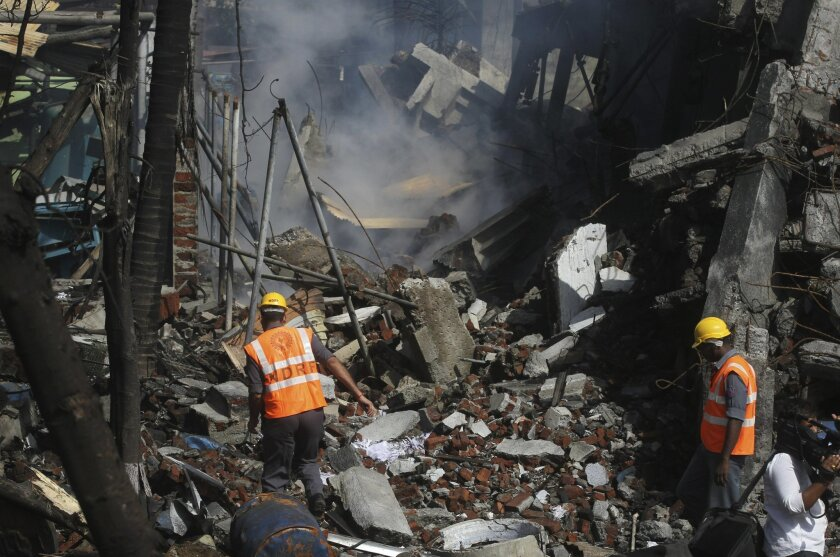 Indian rescue personnels work at the site of an explosion at a chemical factory in Dombivli, in the outskirts of Mumbai, India, Thursday, May 26, 2016. The powerful explosion shattered windows in buildings near the factory. (AP Photo/Rafiq Maqbool)