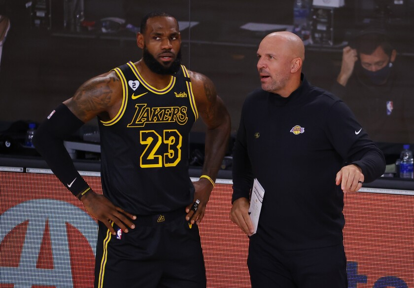 Lakers assistant coach Jason Kidd talks to LeBron James on the sideline.