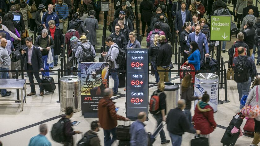 Security lines at Hartsfield-Jackson Atlanta International Airport stretched more than an hour long Monday.