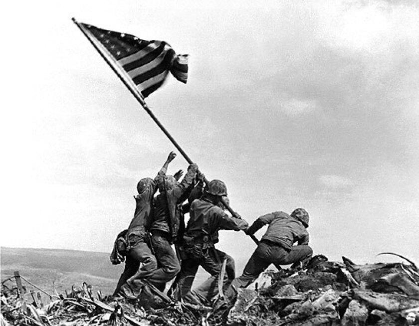 U.S. Marines raise the American flag atop Mt. Suribachi on Iwo Jima on Feb. 23, 1945.