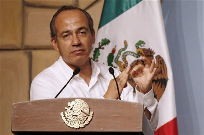 "Mexico's President Felipe Calderon, speaks during the ""Lessons Learned and Preparedness of Swine Flu"" summit in Cancun, Mexico, Thursday, July 2, 2009. (AP Photo/Miguel Tovar)"
