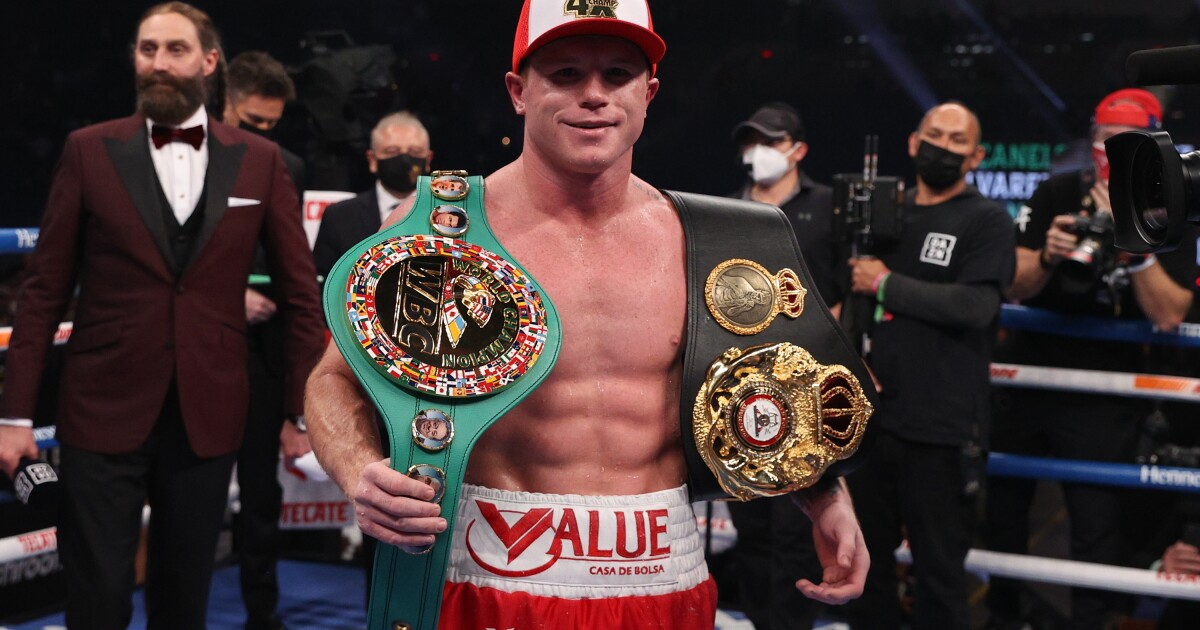 Column: Canelo's unification fight remains true to sport amid circus acts