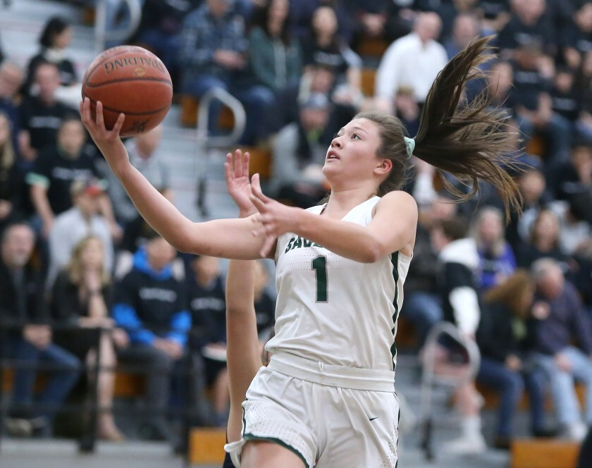 Sage Hill's Emily Elliott drives in for a layup against St. Margaret's in a San Joaquin League game in February 2020.
