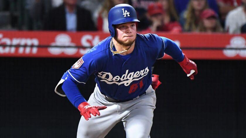 ANAHEIM, CALIFORNIA MARCH 25, 2019-Dodgers Alex Verdugo hits a double against the Angels at Anaheim