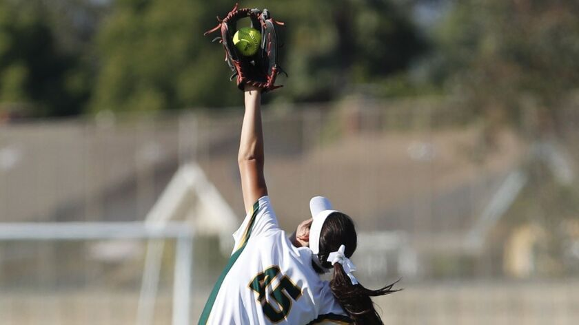 Edison's Serena Starks catches a line drive near the fence by Marina's Shayla Thomas during a Sunset