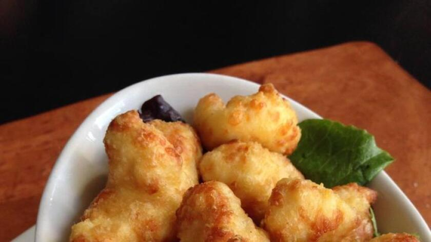 Beer-battered cheese curds at Counterpoint, served with mustard aioli. (Amy T. Granite)
