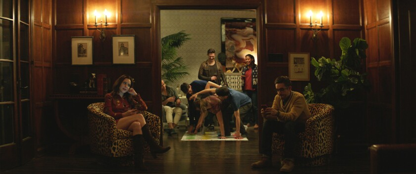 """Michelle Morgan and Jorma Taccone (and a house party game of Twister) in the movie """"L.A. Times."""""""