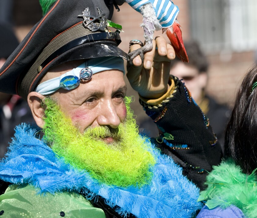 Miss Colombia, the 'Queen of Queens,' is pictured with his pet bird during the Sunnyside, Queens Saint Patrick's Day Parade in 2010.