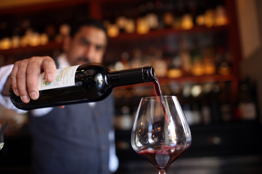 A glass of wine is poured for a customer at A.O.C., named one of the top 10 places to drink in Los Angeles by Gourmet Traveller Wine, an Australian publication.