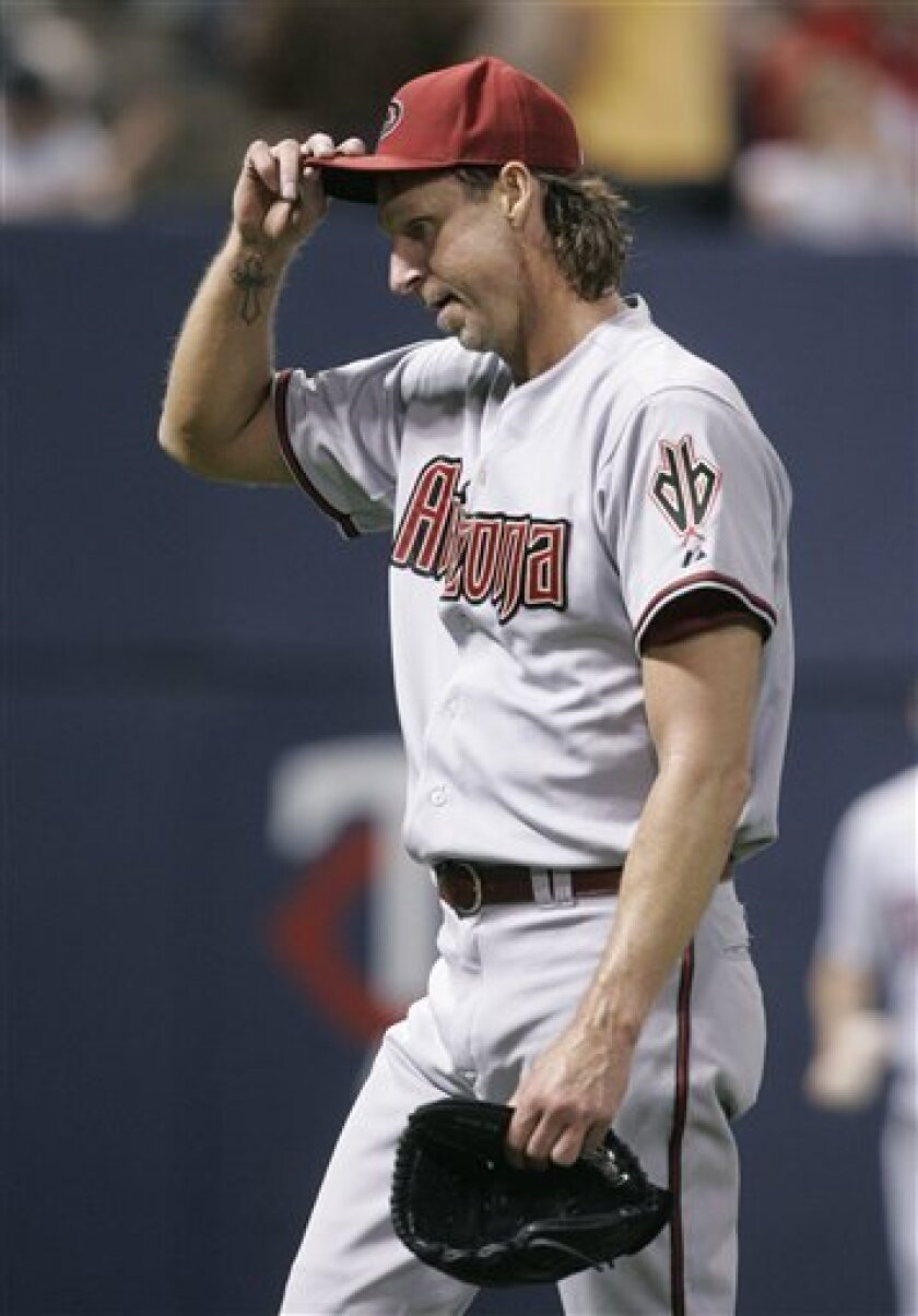 Arizona Diamondbacks pitcher Randy Johnson heads to the dugout after the third inning where he gave up six runs to the Minnesota Twins in a baseball game Friday, June 20, 2008, in Minneapolis. (AP Photo/Jim Mone)