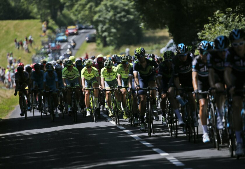 The pack pedals during the fifth stage of the Tour de France cycling race over 216 kilometers (134.2 miles) with start in Limoges and finish in Le Lioran, France, Wednesday, July 6, 2016. (AP Photo/Christophe Ena)