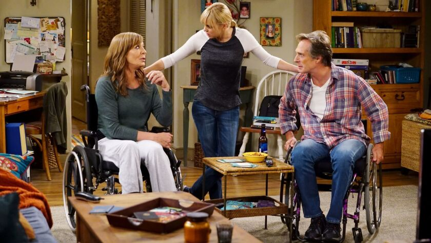 """Bonnie (Allison Janney, left) gets a taste of Adam's (William Fichtner) life when an accident puts her in a wheelchair in a new episode of """"Mom"""" on CBS. With Anna Faris."""