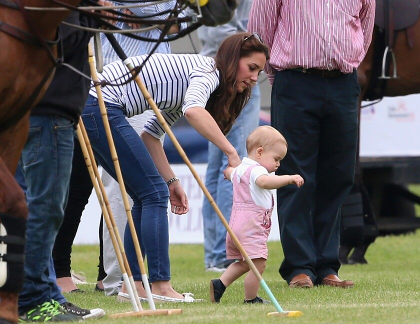 Catherine, Duchess of Cambridge, and Prince George of Cambridge attend the Royal Charity Polo match during the Maserati Jerudong Trophy at Cirencester Park Polo Club.