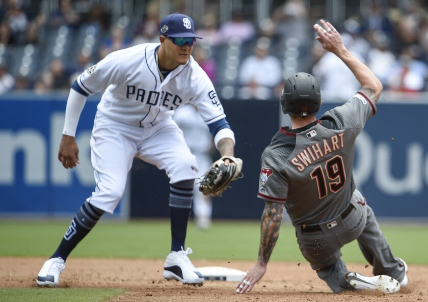 Blake Swihart of the Diamondbacks is tagged out by Manny Machado of the Padres on May 22, 2019 at Petco Park.