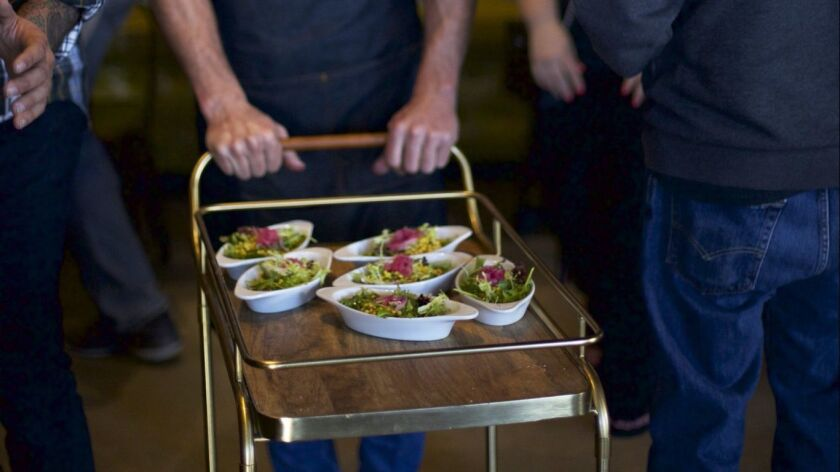 A chef pushes a passaggi cart through the modern Italian restaurant in Hillcrest, Maestoso.