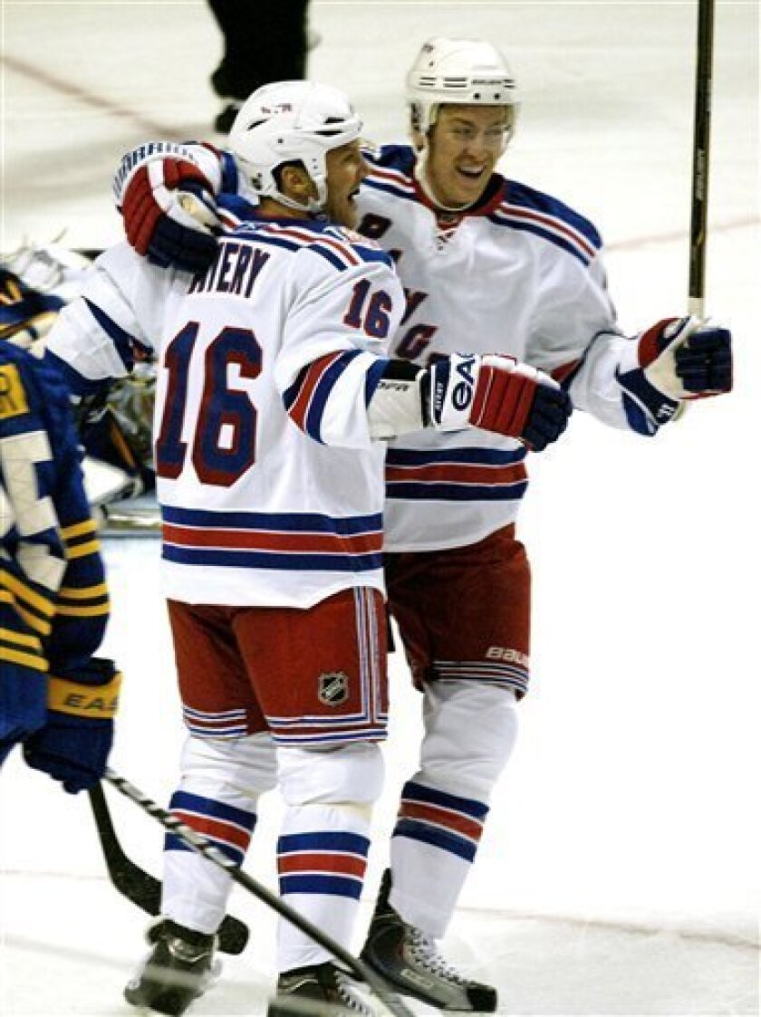 New York Rangers center Derek Stepan, right, is congratulated by Rangers Sean Avery after his first goal during the first period of an NHL hockey game against the Buffalo Sabres in Buffalo, N.Y. on Saturday, Oct. 9, 2010. (AP Photo/Don Heupel)