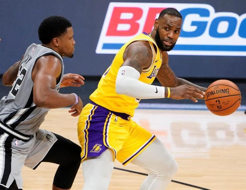 The Los Angeles Lakers' LeBron James (right) in action against the San Antonio Spurs' Rudy Gay during an NBA game on Oct. 27, 2018, at the AT&T Center in San Antonio. EPA-EFE/DARREN ABATE