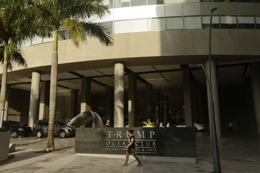 A woman past walks past the main entrance to the Trump Ocean Club International Hotel and Tower in Panama City, on Feb. 23, 2018.