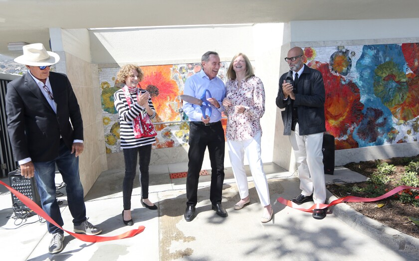 Laguna Beach City Council gathers to officially open the renovated South Main Beach restroom with a ribbon-cutting ceremony.