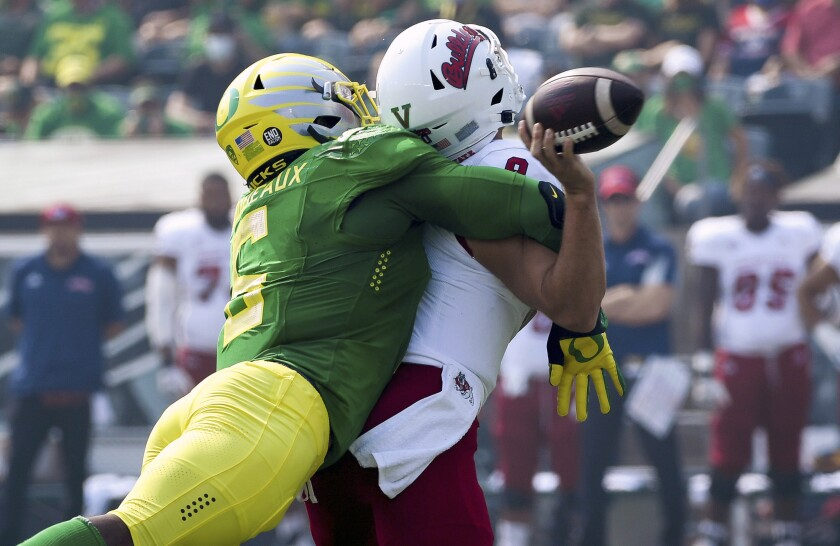 Oregon defensive end Kayvon Thibodeaux (5) hits Fresno State quarterback Jake Haener (9) causing a fumble during the first quarter of an NCAA college football game, Saturday, Sept. 4, 2021, in Eugene, Ore. (AP Photo/Andy Nelson)