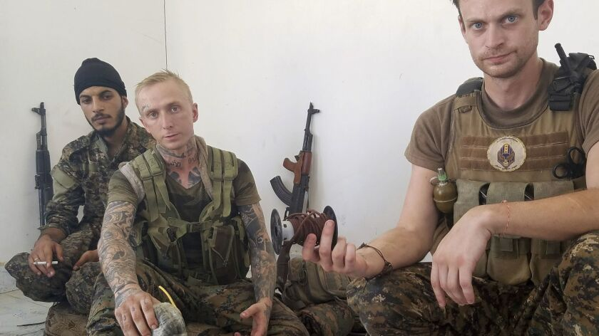 At their west Raqqah outpost last week, Syriac Military Council fighters, from left, Hasan Abja, Kev