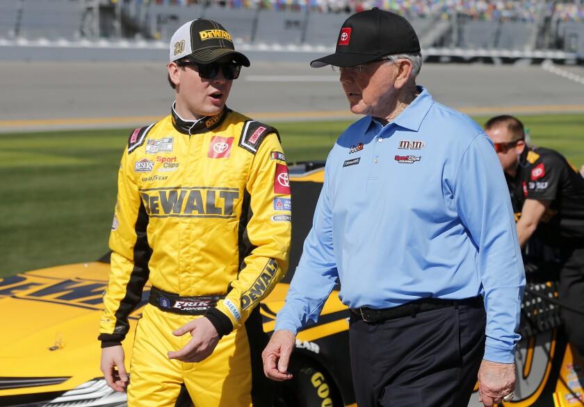 NASCAR driver Erik Jones, left, talks with team owner Joe Gibbs during qualifying the Daytona 500 on Feb. 9.