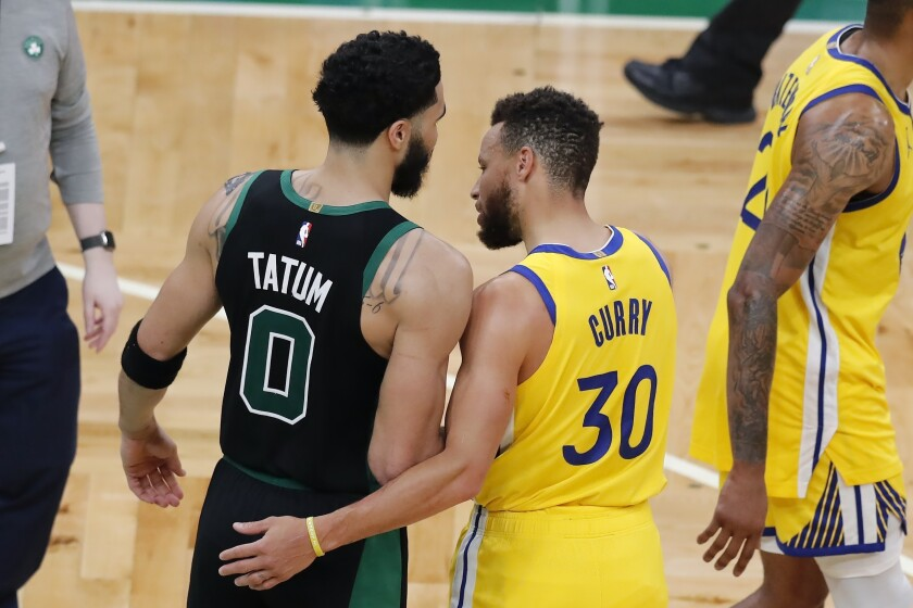 Boston Celtics' Jayson Tatum (0) and Golden State Warriors' Stephen Curry (30) talk following an NBA basketball game, Saturday, April 17, 2021, in Boston. (AP Photo/Michael Dwyer)