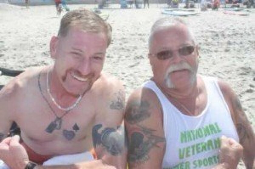 Iraq War veteran Gordon 'Gordy' Ewell and Vietnam War veteran Dave Aitken show off their military tattoos.