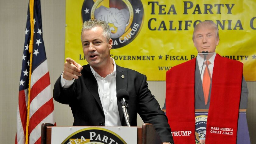 Republican gubernatorial candidate Travis Allen speaks on repealing the gas tax increase at a conference of the Tea Party California Caucus in Fresno last summer.
