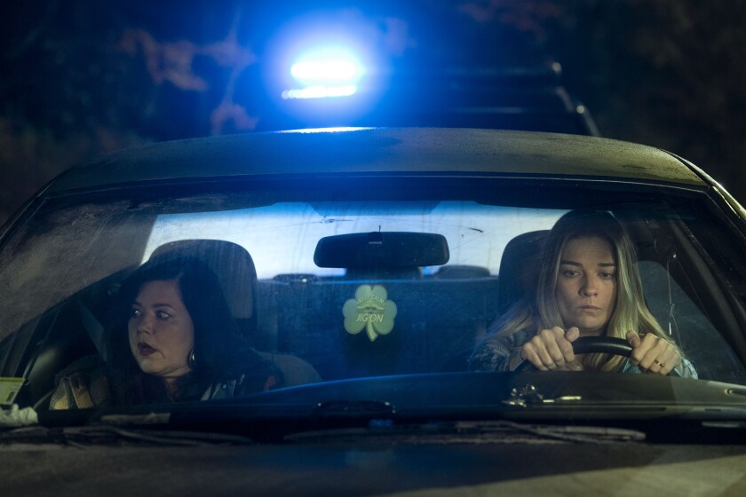 Two women in a car at night