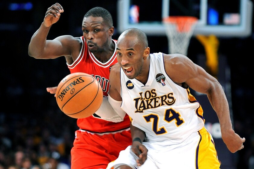 Lakers guard Kobe Bryant and former Bulls forward Luol Deng chase down a loose ball.