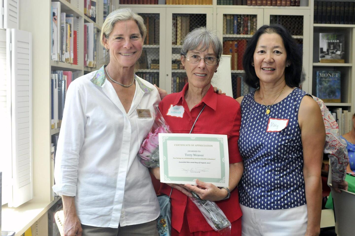 Erika Desjardins, RSF Library Guild volunteer of the year Terry Weaver, Mary Liu
