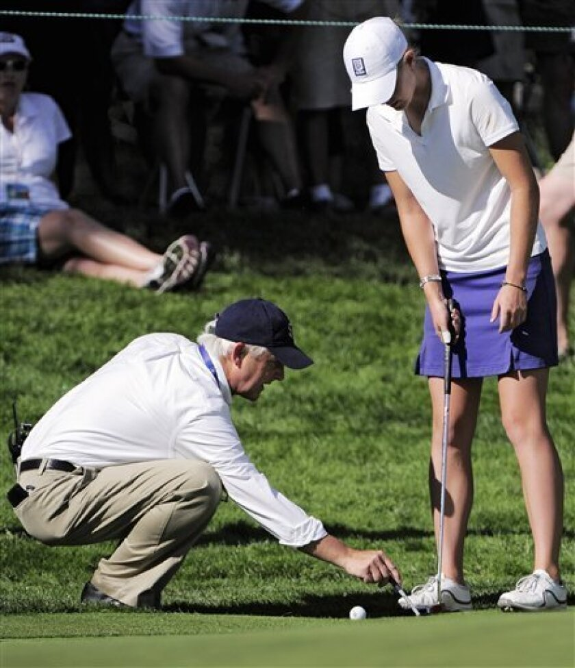 USGA official Jerry Lemieux shows Amateur Amy Anderson where she can drop the ball during the conclusion of the delayed second round of the Women's U.S. Open golf tournament at the Broadmoor Golf Club on Saturday, July 9, 2011, in Colorado Springs, Colo. (AP Photo/Mark J. Terrill)